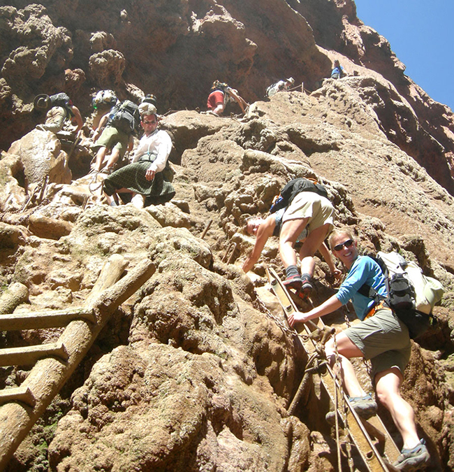 Scaling the travertine walls in the Grand Canyon to Mooney Falls
